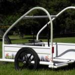 Un carrito para salir en bicicleta con tus perros y hacer ejercicio, un invento simple para ganar dinero
