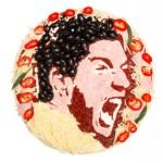 Dinero y mundial de fútbol, una pizza con la cara de Suarez, el goleador uruguayo